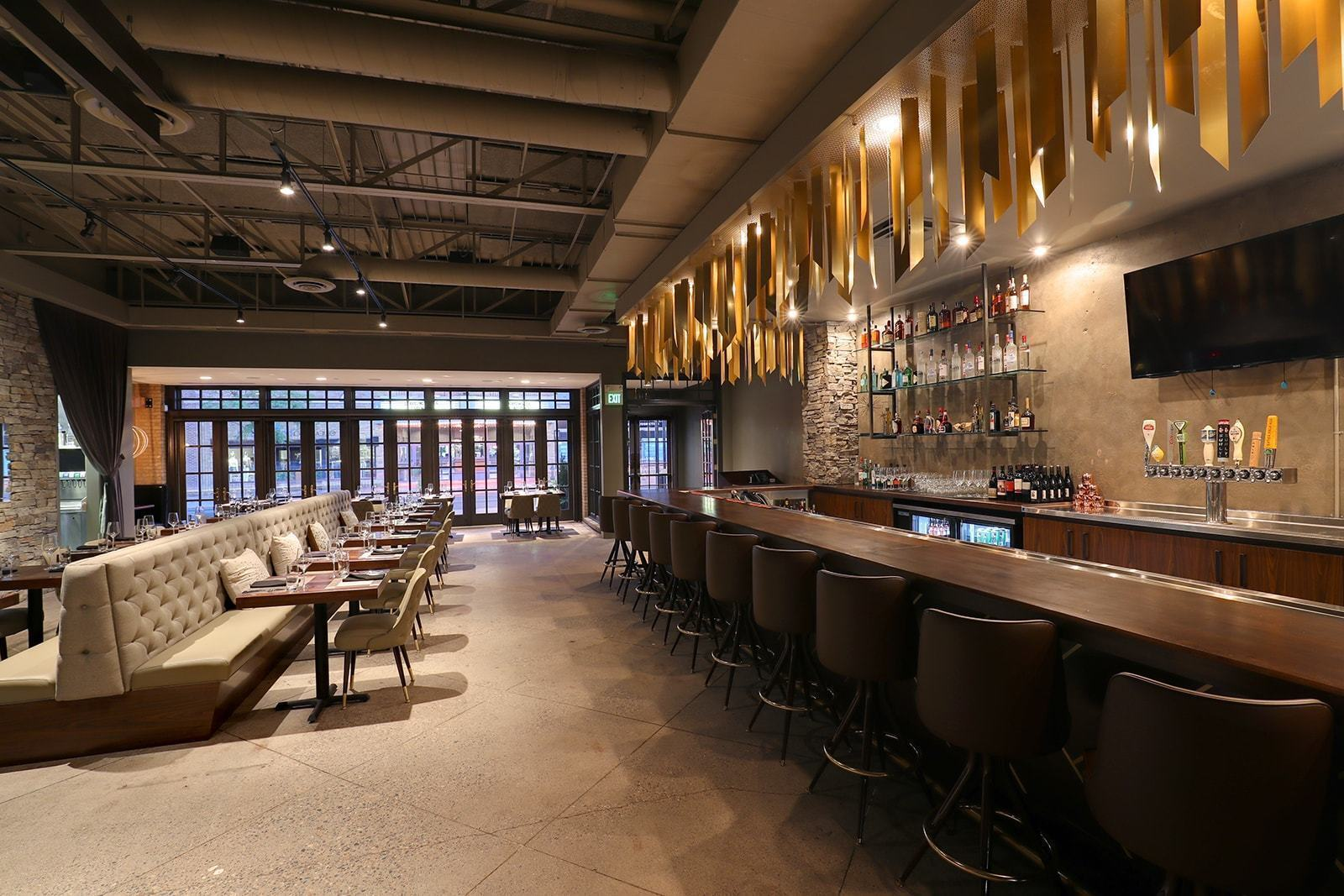 A view of the bar the dining area at Moderna Kouzina in Edina, Minnesota, by Diversified Construction.