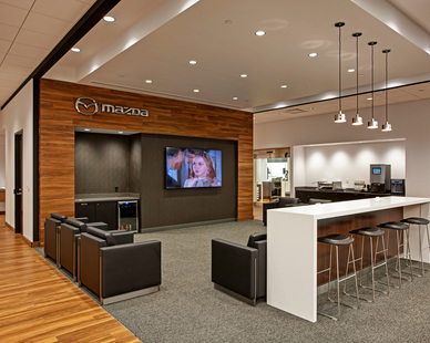 Warm hardwood floors run throughout much of the new dual Luther Mazda Mitsubishi Dealership in Brooklyn Center, Minnesota, created a comfortable and welcoming environment for their shoppers.