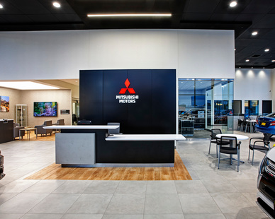 The Mitsubishi sales floor at the dual, Luther Mazda Mitsubishi Dealership, in Brooklyn Center, Minnesota, feature a sleek and modern service counter area.
