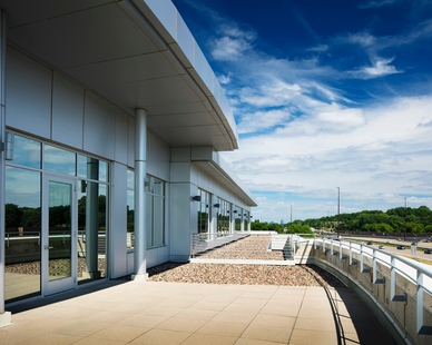 The bright exterior balcony at the Helmuth & Johnson offices in Edina, Minnesota, by DJR Architecture.