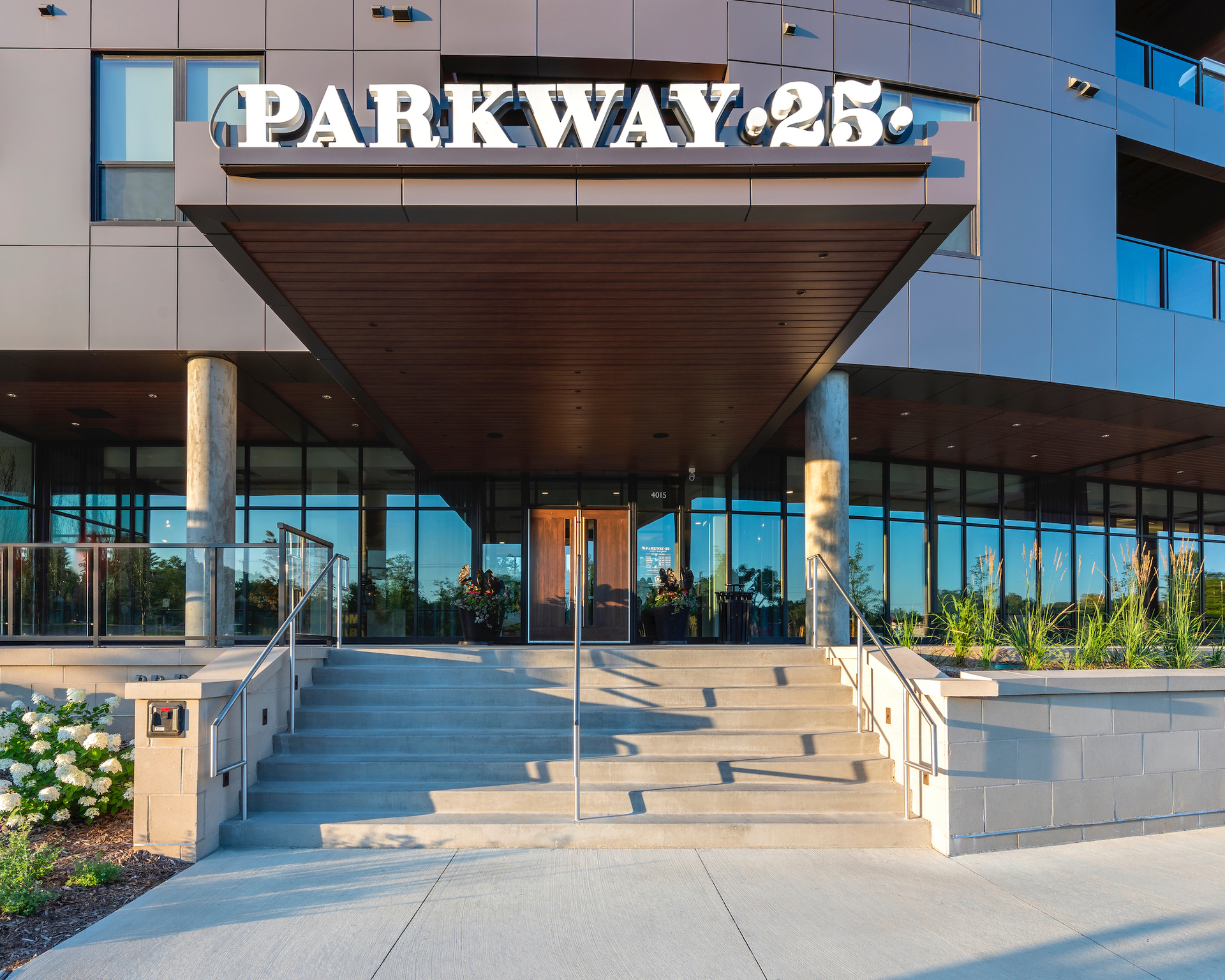 The large entrance canopy shelters guests and tenants by also adding a bold exterior design element to the apartment building at Parkway 25 in St. Louis Park, MN.