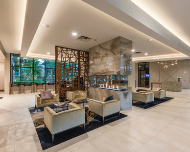 The eye-catching entrance lobby design featuring marble and wood elements at Parkway 25 in St. Louis Park, MN, by DJR Architecture.