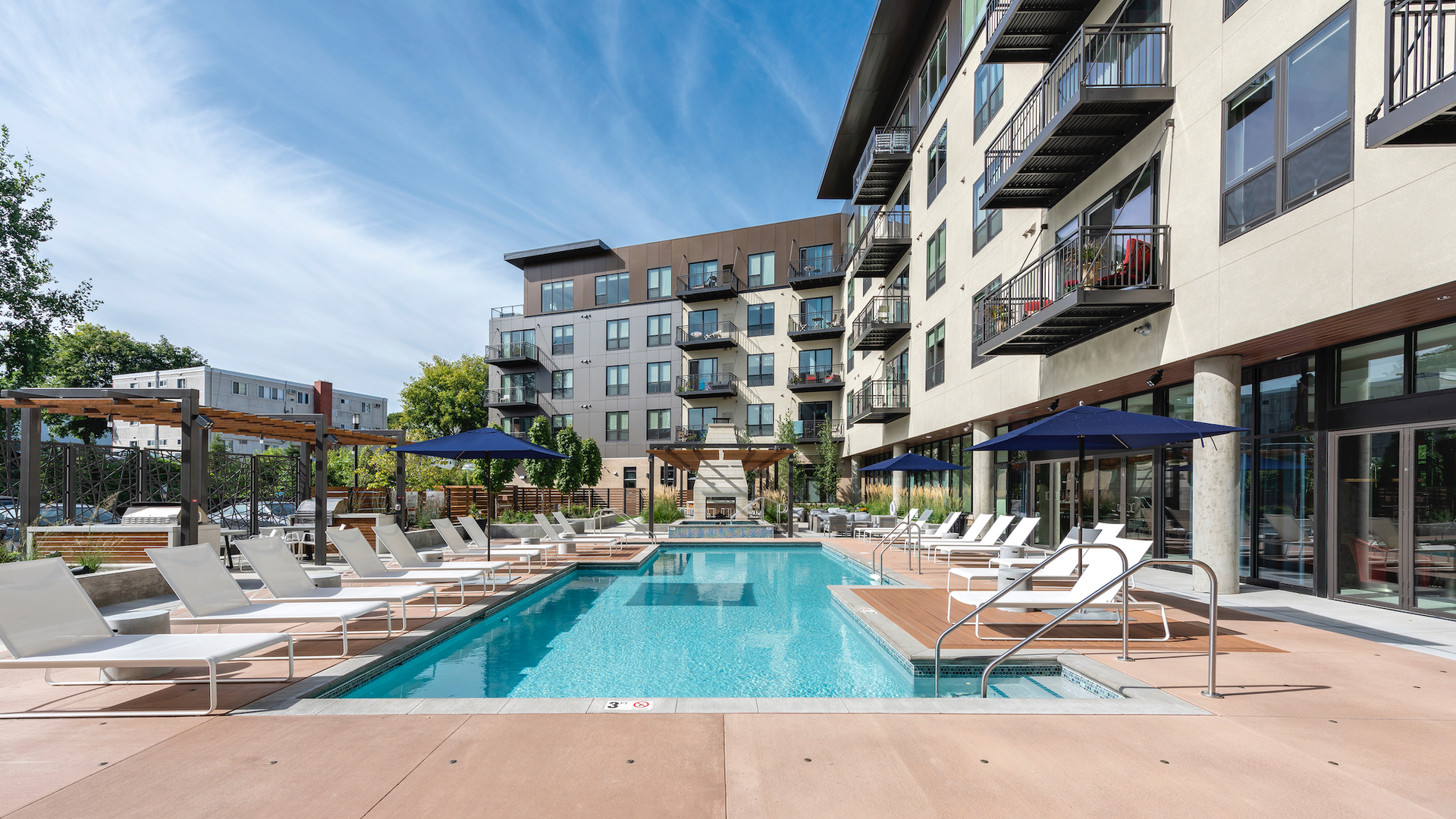 The outdoor swimming pool area at Parkway 25 in St. Louis Park, MN, designed by DJR Architecture.