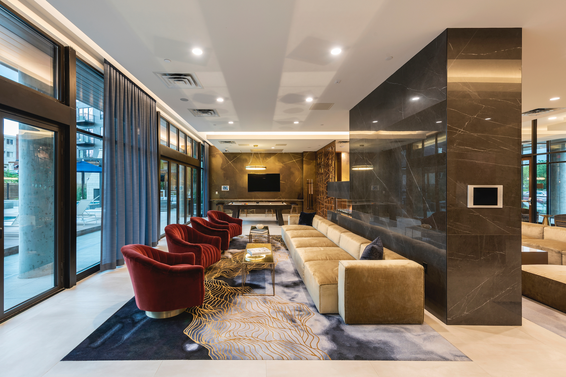 The eye-catching lounge area for guests to enjoy a round of pool or just gather together at Parkway 25 in St. Louis Park, MN, by DJR Architecture.