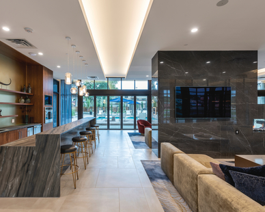 The versatile common area provides guests and tenants with various gathering areas and ample room for activities at Parkway 25 in St. Louis Park, MN, by DJR Architecture.
