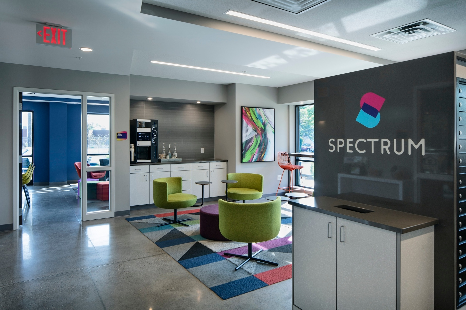 The colorful common area for guests to enjoy at the Spectrum apartments in Minneapolis, Minnesota, by DJR Architecture.