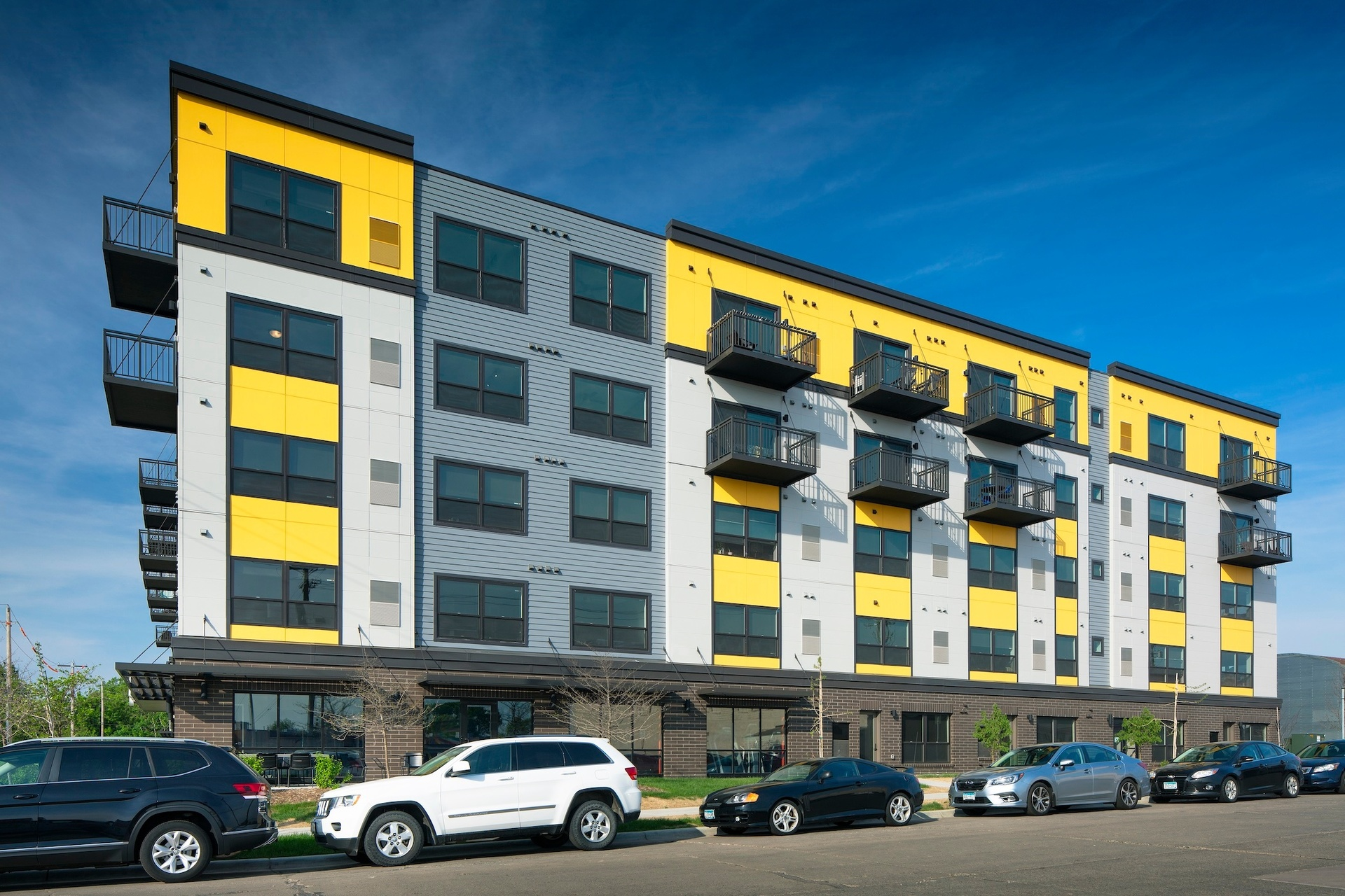 Bright exterior design and finish at the Spectrum apartments in Minneapolis, Minnesota, by DJR Architecture.