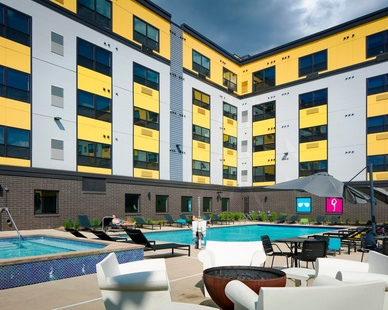 Sunshine and comfort at the outdoor pool at the Spectrum apartments in Minneapolis, Minnesota, by DJR Architecture.