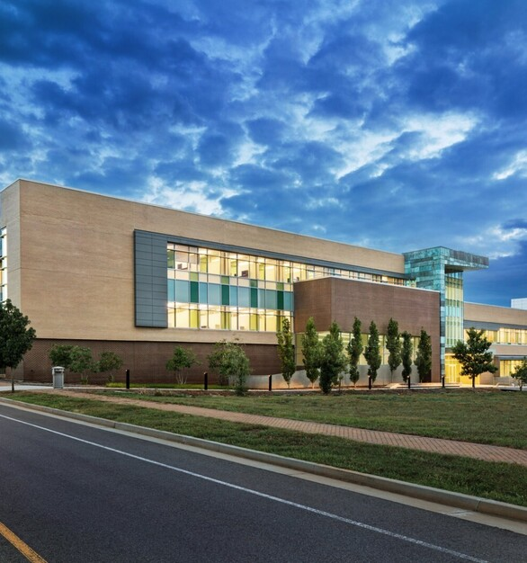 Stunning mix of stone and copper treated cladding, by DLSS Manufacturing makes for the most beautiful exterior. Seen here at the University of Tennessee Joint Institute for Advanced Materials.