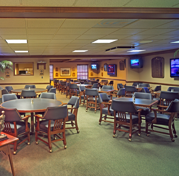 Classic dining and bar area at Doylestown Country Club featuring chairs provided by Gasser Chair.