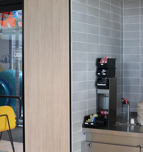 MLU-100 used as a corner guard with tile and panels in a McDonald's restaurant.
