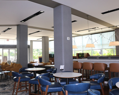 The common area at the Courtyard Marriott at The Navy Yard features Tedlar™ Wallcoverings that provides a durable design that'll have a longlasting impression for guests and visitors for years to come.