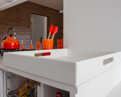 A clean, solid surface countertop is the perfect option for any kind of apartment space.