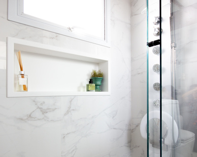 Built-in shower shelving using Durasein's solid surface material.