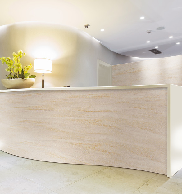 Sleek and chic is how to describe Durasein's solid surface used as the countertop here at this reception desk.
