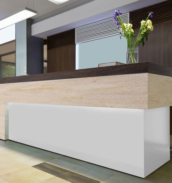 Seen here is a gorgeous reception desk featuring Durasein's custom solid surface countertop.
