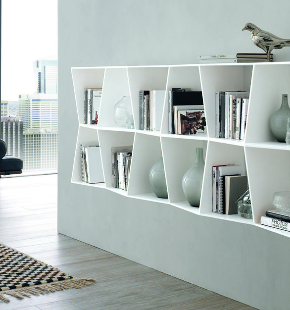 Custom shelving by Durasein which consists of their solid surface material is the perfect modern addition to this space.