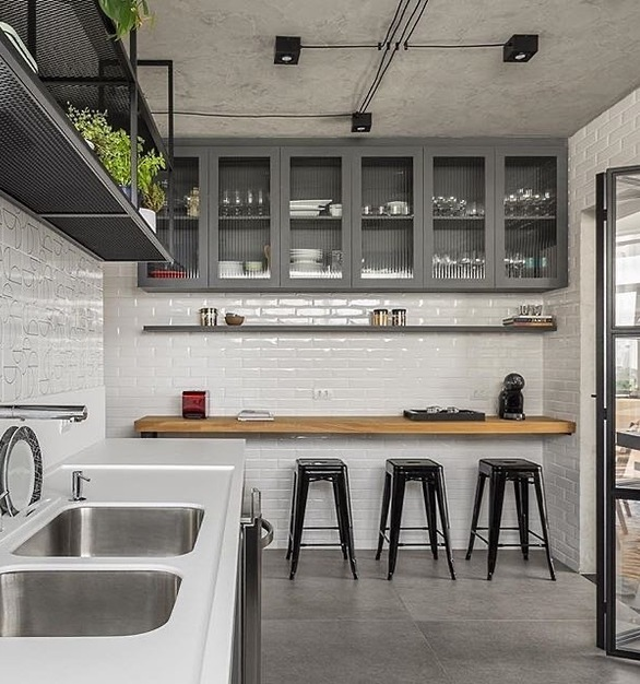 Making the most out of a renovated apartment kitchen is what the designer did with this space. Using Durasein solid surface material for the countertops.