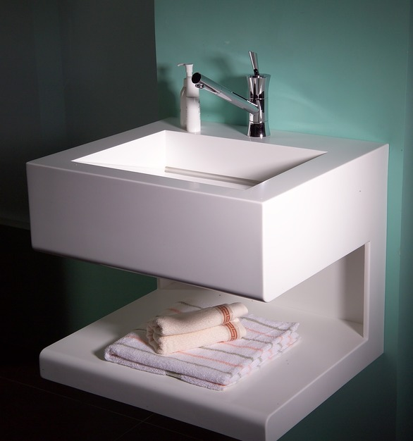 Custom build solid surface sink from Durasein also comes with a handy shelf.