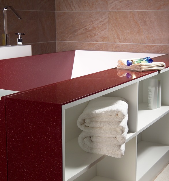 Custom, solid-surface bathtub with built-in shelving by Durasein.