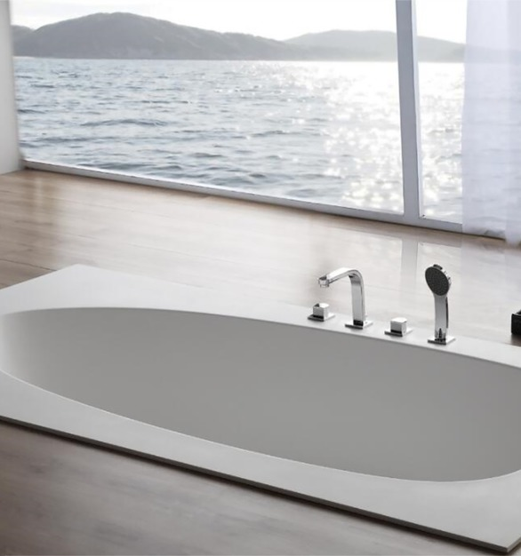 Solid-surface material bathtub built into the floor. Avoids any obstruction to a view while you relax at your hotel.