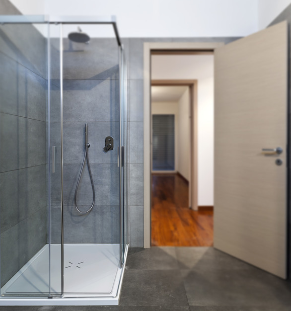 All glass shower showcasing Durasein's solid surface material for the floor.