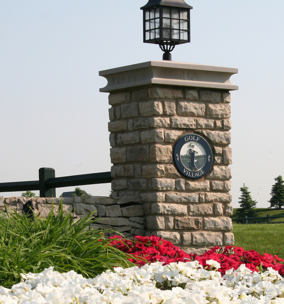 Dutch Quality Stone provided their Ohio Tan Limestone for this entrance post with signage.