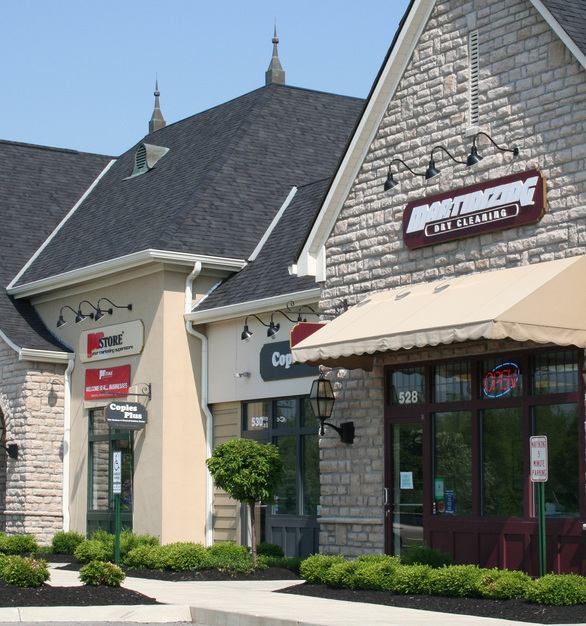 Here at a strip mall with more than one retail space, Dutch Quality Stone's Limestone in Ohio Tan looks perfect with all the colors and branding for each retail store.