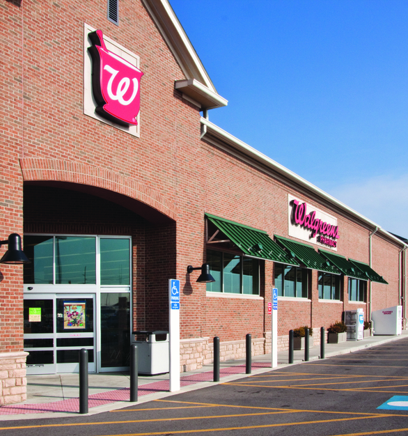 Mixing Dutch Quality Stone's Ohio Tan Limestone with brick makes this Walgreens exterior really stand out and stay within the brand.