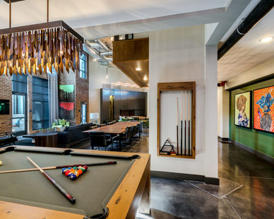 The inviting game area at The Point at Ridgeline apartments by Dwell Design Studio.