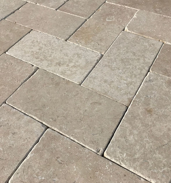 The Galala Limestone Pavers by Earth Surfaces are light cream colored with hints of ginger.