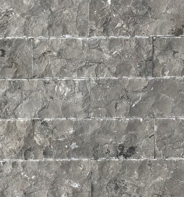 The Sina Grey Limestone Veneers by Earth Surfaces feature a beautiful gray with pronounced movement.