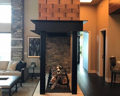 This ventless Earthcore fireplace has the ability to be see-through and to customize for any space.