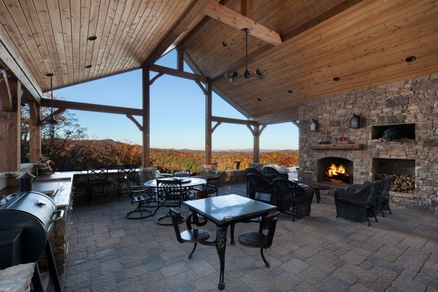 Outdoor patio at the Mountain Falls Luxury Motorcoach resort showcasing one of Earthcore's custom fireplaces.