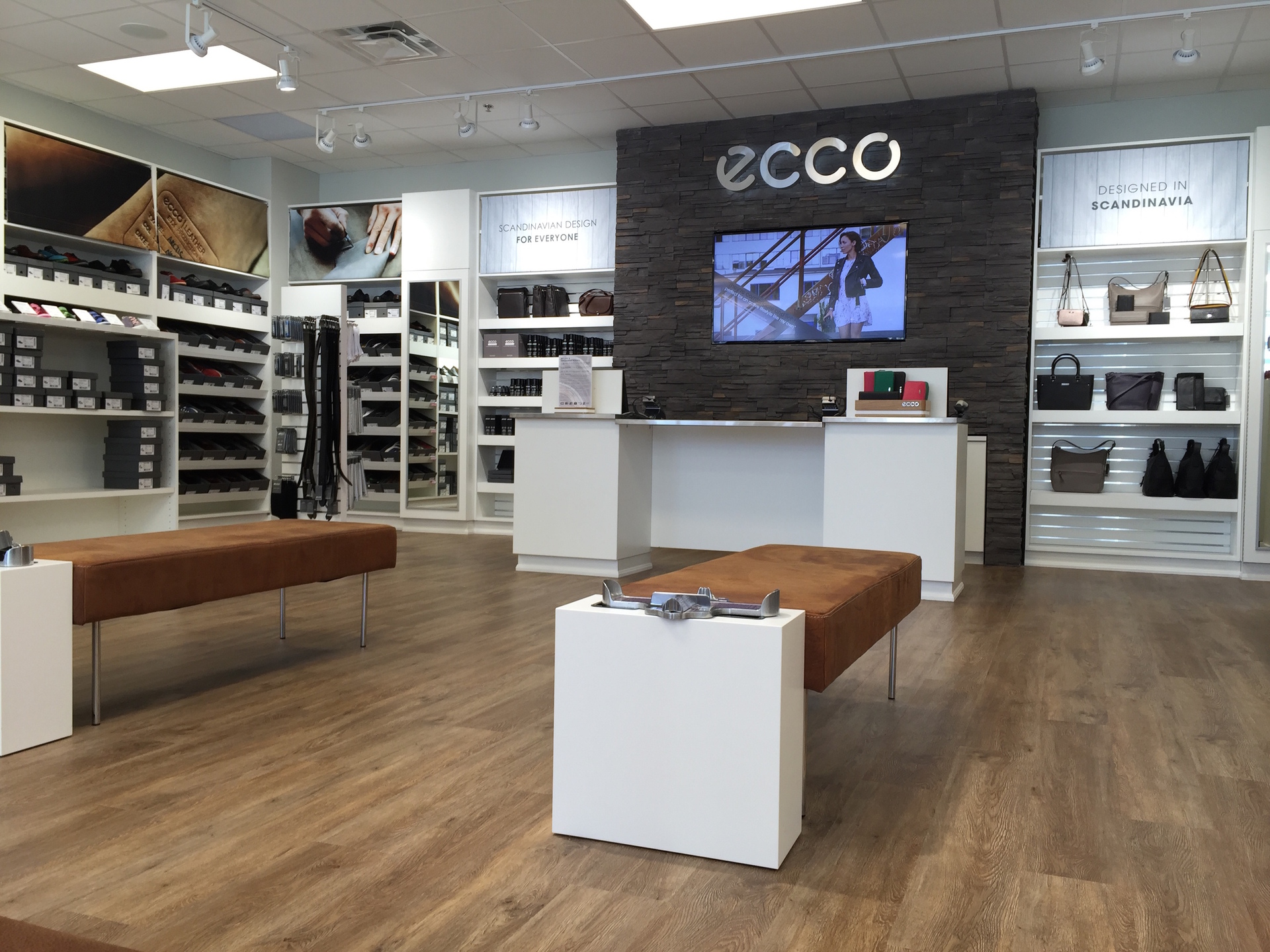 Updated and modern ecco retail location boasting custom architectural molding and millwork by Dras Cases.
