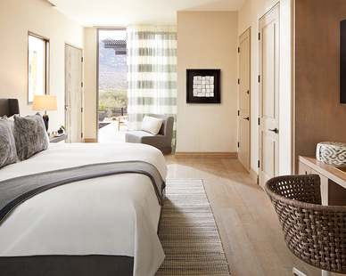 Comfortable and cozy bedroom at the Miraval Arizona Resort & Spa, custom furnished by Eclectic Contract.