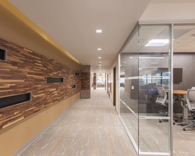 Man on the Move used ASI Interwoven Eco-Panels to create a fun accent wood wall.  The variegated wood colors and depths make it a great focal point in their office.