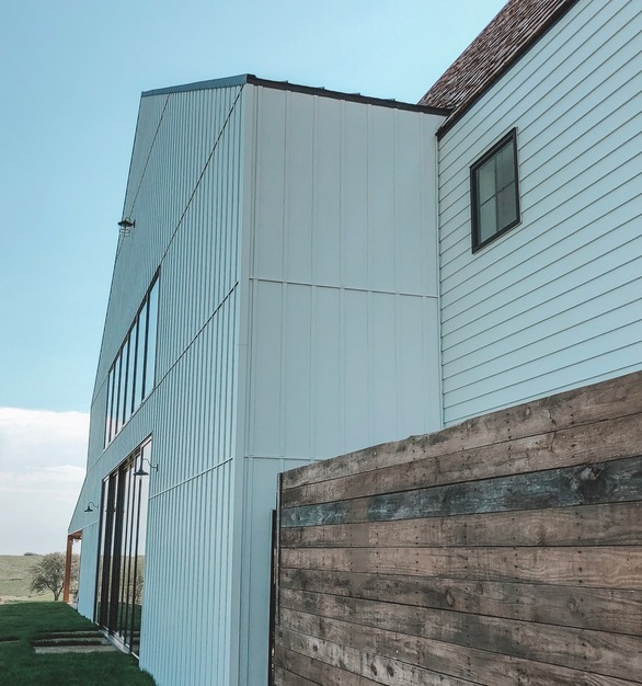 "EDCO's ENTEX D4"" Traditional Lap Siding in Glacier White is featured on the Little Light on the Lane wedding venue."