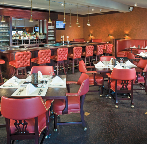 Modish dining and bar area at Edgeworth Club Bar featuring chairs by Gasser Chair.