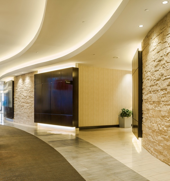 Cut Coarse Stone by Eldorado Stone in Oyster adds dimension to this hotel lobby.
