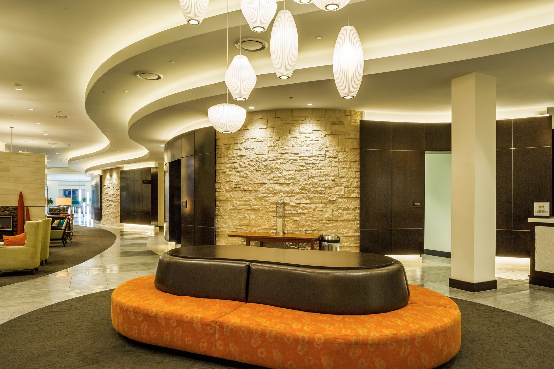 The lobby at the Hilton Garden Inn in Nashville, Tennessee showcases Eldorado Stone's Cut Coarse Stone in Oyster.
