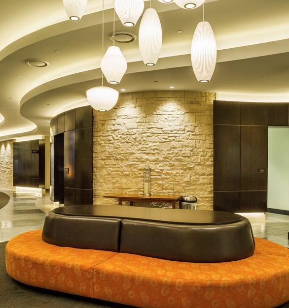 The lobby at the Hilton Garden Inn in Nashville, Tennessee showcases Eldorado Stone's Cut Coarse Stone in Oyster.