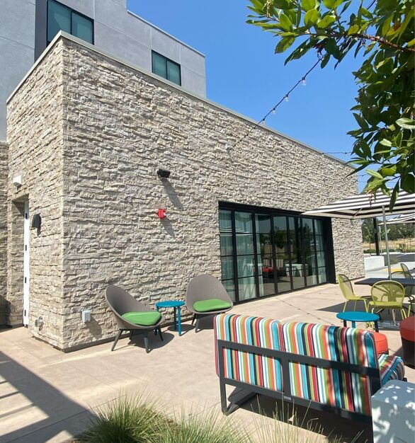 eldorado stone home2suites by hilton exterior seating area