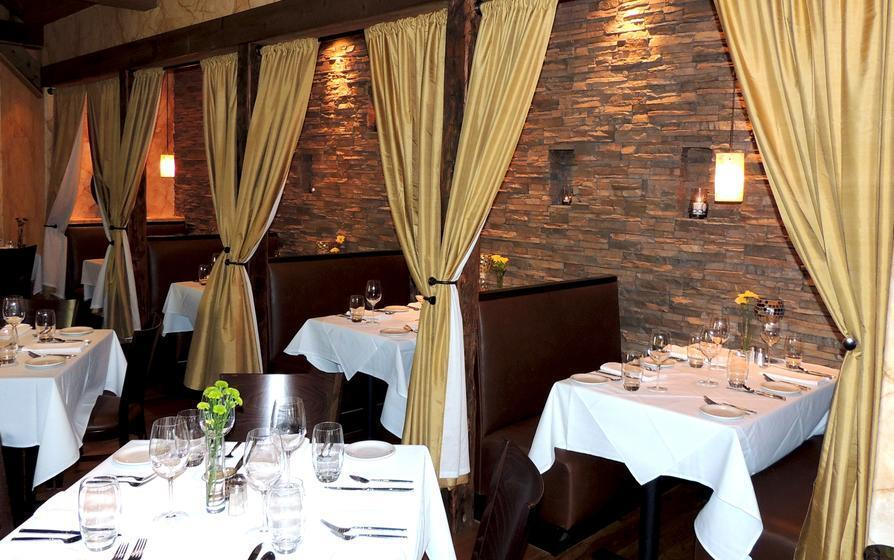 Beautiful private dining booths are surrounded by Eldorado Stone's Castaway® in their stacked stone profile.