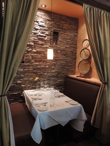 Some of the dining at The Livery Tavern is tucked away for a private booth experience which includes the beautiful Stacked Stone profile by Eldorado Stone in Castaway®.