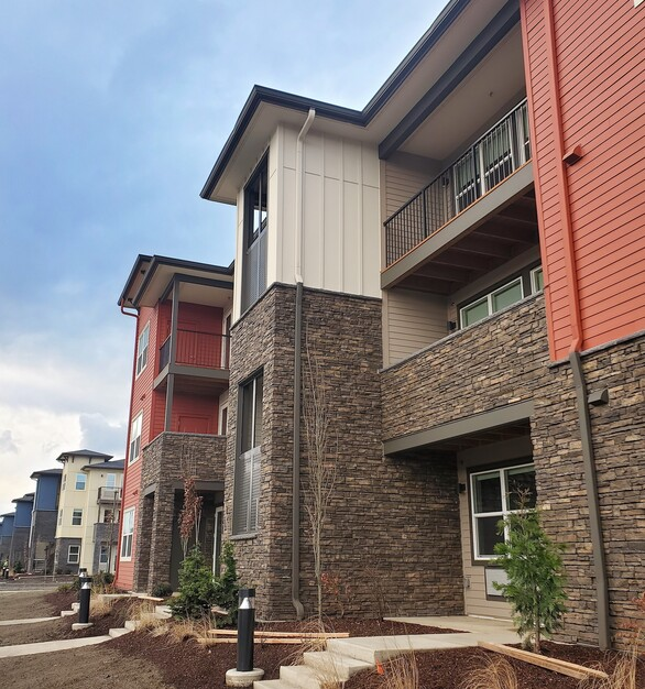 The exterior of the Zera Apartments uses a variety of Eldorado Stone's products, seen here is the Mountain Ledge Panels in Whiskey Creek®.