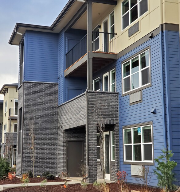 The Zera Apartments used Eldorado Stone to mix in a natural, gray tone with the bright colors of the siding.