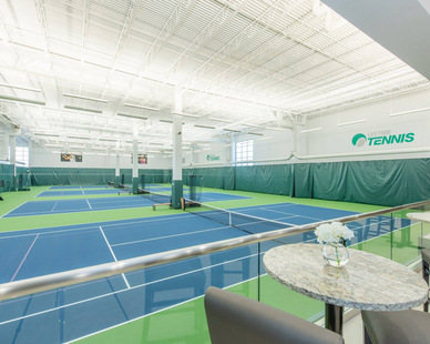Indoor tennis courts at Life Time Fitness, by Emanuelson-Podas.