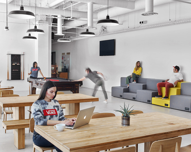 A luminous versatile space at the Vans corporate headquarters in Costa Mesa, California, featuring the Original™ Warehouse Pendant by Barn Light Electric. Photos by Eric Laignel
