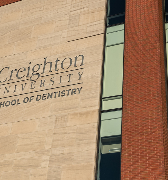 Endicott Clay Products Creighton University School of Dentistry Exterior Thin Brick and Etched Stone Branding Facade